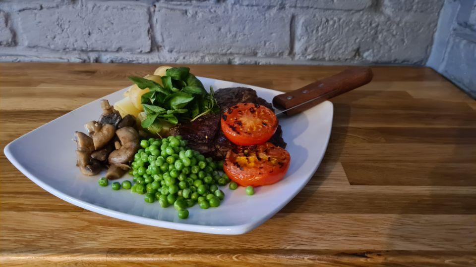10oz Rib-eye Steak, Peas, Mushrooms, Tomato and New Potatoes
